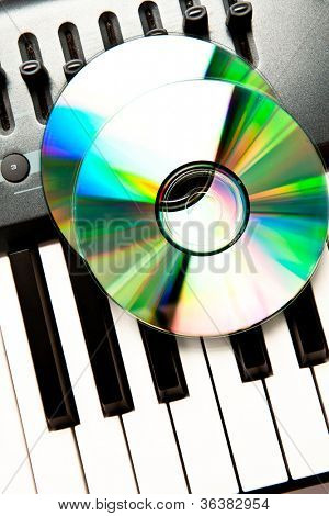 Close up of a compact disc on a grey synth