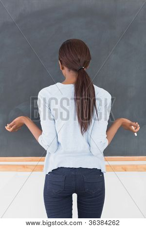 Black woman seeming uncertain in a classroom