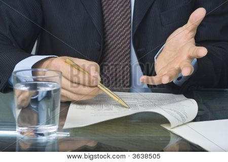 Businessman Writing In A Document