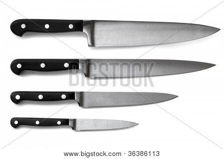 Set of steel kitchen knives, isolated on white with soft shadows. Includes carving, paring, and utility knives.