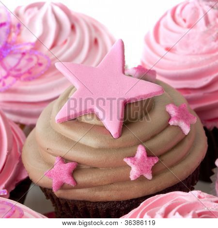 Chocolate cupcake with pink stars.