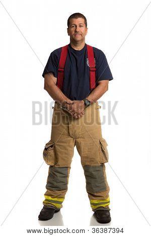 Feuerwehrmann stehend Ganzkörper Länge Portrait zu isolieren, auf Withe-Hintergrund