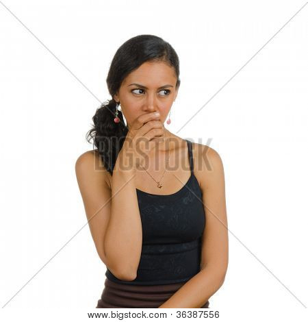 A girl holding her hand over her mouth. Isolated on white. Body language. Manifest of telling untruth.