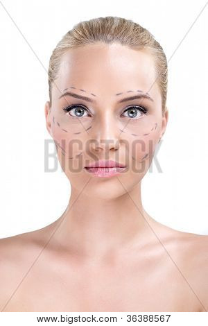 Portrait of a pretty woman's face marked with lines for facial cosmetic surgery