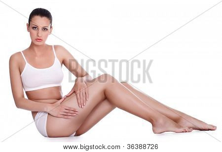 Young attractive woman showing cellulite on her legs
