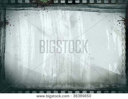 Computer designed highly detailed film frame on aged paper background , with space for your text or image.
