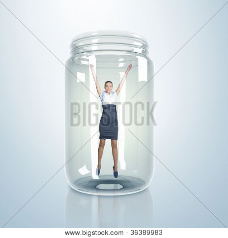 Businesswoman trapped inside a transparent glass jar