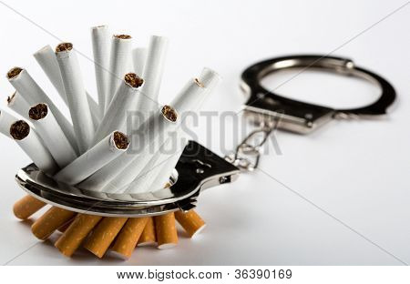 Heap of cigarettes locked to handcuffs