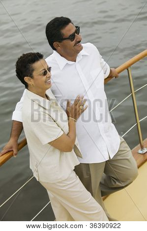 Happy man and woman spending time together on the yacht