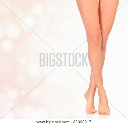 Legs of a woman against abstract background with circles and copyspace