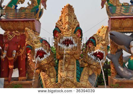 The famous Golden Triangle. Place on the Mekong River, which borders three countries - Thailand, Myanmar and Laos. Dragons, elephants and fish. Fountain