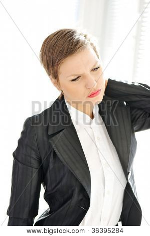 Young business woman suffering from severe neck pain