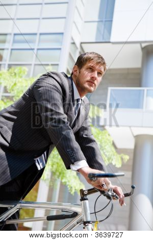 Caucasian Businessman Riding A Bike