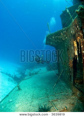 Underwater Photographer Taking Pictures Of A Sunken Ship