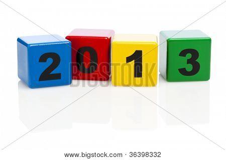 2013 printed on four alphabet building blocks