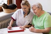 picture of crutch  - blond nurse visiting a senior patient at home - JPG