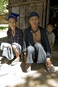 foto of hmong  - Old man and woman Hmong Laos sit in front of her accommodation
