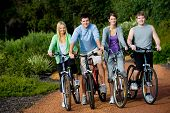 Young Adults On Bikes