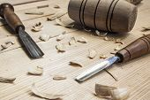 picture of woodcarving  - joiner tools hammer and chisel on wood table background - JPG