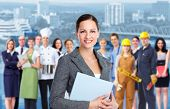 stock photo of electrician  - Smiling Business woman and Group of industrial workers - JPG