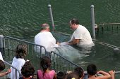 YARDENIT , ISRAEL - SEPTEMBER 30: Baptismal site at Jordan river shore. Baptism of pilgrims  in Yard
