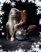 pic of fetish fishnet stockings  - party dancer girl in fishnet stockings with disco ball - JPG