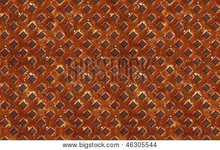 seamless pattern of textured rusty metal with diagonal grid