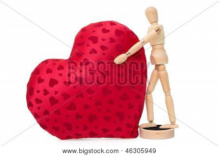 Wooden Mannequin With A Gigantic Soft Red Heart