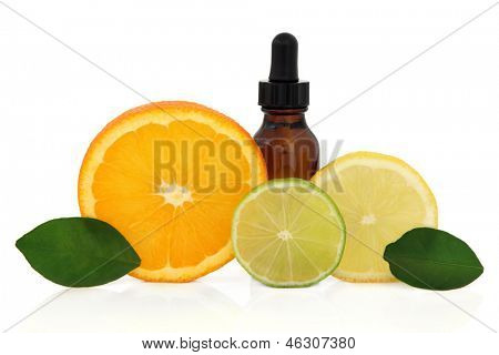 Aromatherapy essential oil bottle with lemon, lime and orange citrus fruit with leaf sprigs over white background.