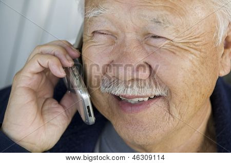 Extreme closeup of a senior man using mobile phone