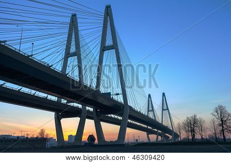 Big Suspended Bridge During Sunrise On Blue Sky
