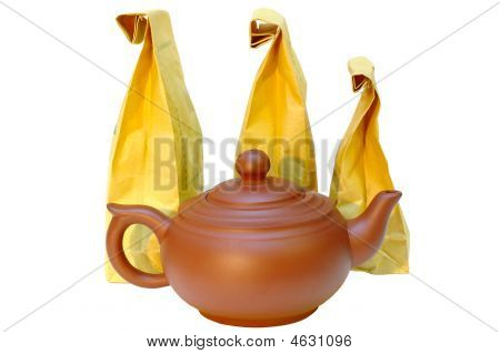 Pottery (clay) Teapot And Tea In Paper Bags.