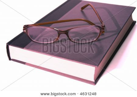 Book With Eyeglasess On Top Full View