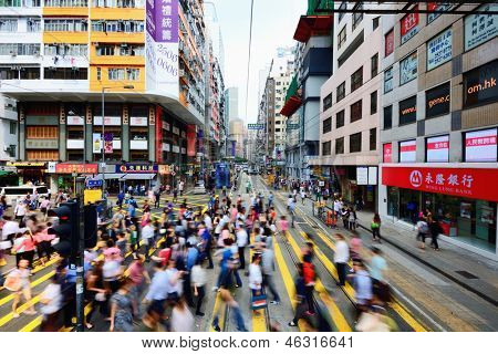 HONG KONG - OCTOBER 9: Pedestrians cross the Tramway tracks October 9, 2012 in Hong Kong, China. The line has been running for over 100 years.