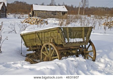 Old Vehicle In Russian Village, Winter