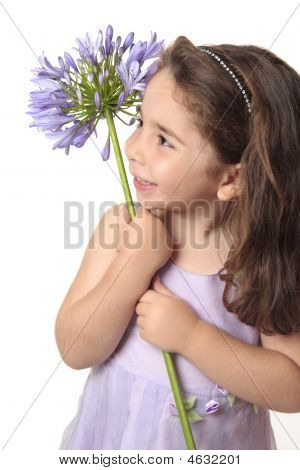 Pretty Girl Holding A Beautiful Flower
