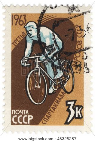 Bicyclist On Post Stamp