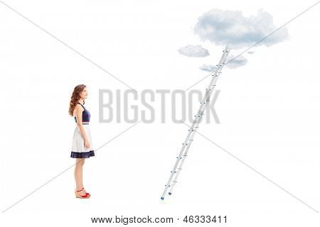 Full length portrait of a young female standing in front of a ladder with cloud and looking, isolated on white background