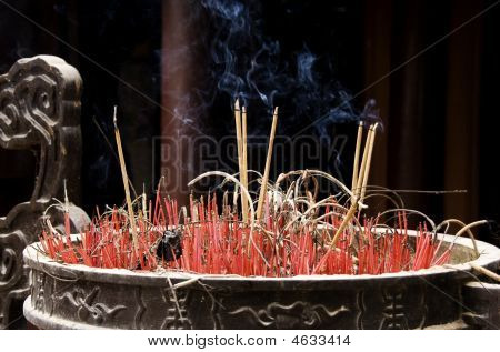 Smoking Candles In Big Pot In Vietnamese Temple