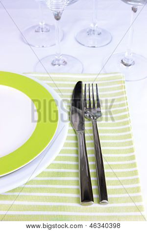 Table setting with glasses for different drinks on table close-up