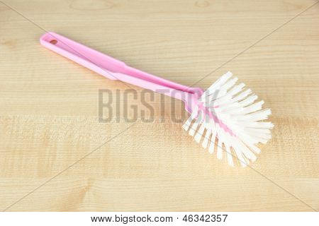 Toilet brush on wooden background