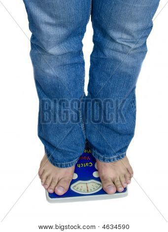 Feet And Weight Scale Isolated On White Background