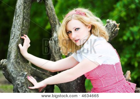 Blonde Beautiful Girl On Tree