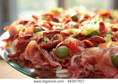 Platter with spanish cured ham on table