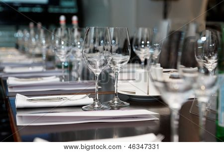 Table set for official dinner, focus on glasses