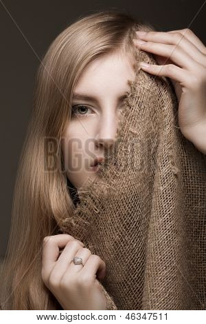 beautiful blond woman with gunny veil on her face