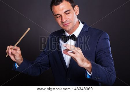male conductor on black background