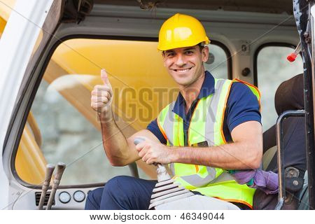 earthmover operator giving thumb up on construction site