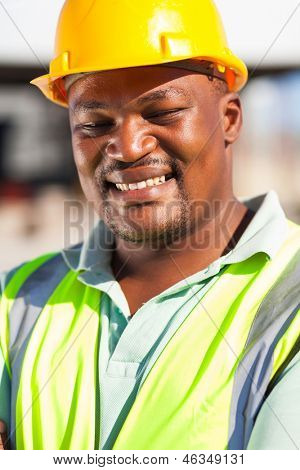 cheerful african american male construction worker outdoors