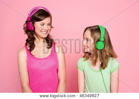Two Teenage Friends Enjoying Music Together
